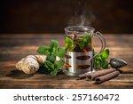 cup of herbal tea with fresh... | Shutterstock . vector #257160472