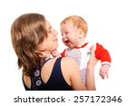 mother holding her son and... | Shutterstock . vector #257172346