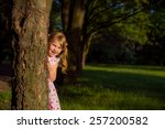 little girl hugging a tree | Shutterstock . vector #257200582