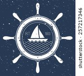 Nautical Logo With A Sail Boat...