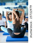 Women in a stretching class at the gym - stock photo