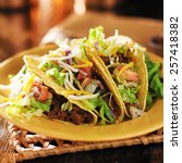 three beef mexican tacos with... | Shutterstock . vector #257418382