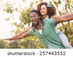 cute couple in the park on a... | Shutterstock . vector #257443552