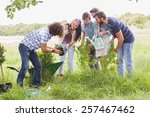 happy friends gardening for the ... | Shutterstock . vector #257467462