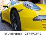 Постер, плакат: Parked bright yellow Porsche