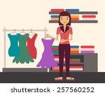 sales clerk. girl holding a...   Shutterstock .eps vector #257560252