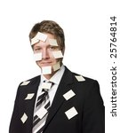 Man with post-it notes all over his face - stock photo