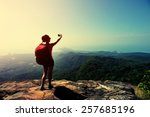 woman hiker taking photo with... | Shutterstock . vector #257685196