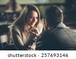 Romantic young couple dating and flirting at the bar, staring at each other
