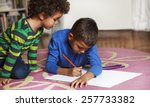 young mixed race boys drawing... | Shutterstock . vector #257733382