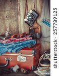 old travel suitcase  sneakers ... | Shutterstock . vector #257789125