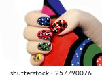 Colorful Manicure On Nails Wit...