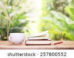 notebook  and coffee on wooden... | Shutterstock . vector #257800552