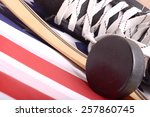 puck  skates and hockey stick... | Shutterstock . vector #257860745