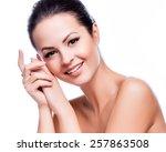 beautiful young woman touching... | Shutterstock . vector #257863508