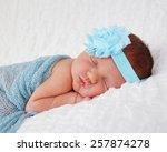 newborn baby wearing blue and... | Shutterstock . vector #257874278