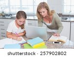 mother using laptop while... | Shutterstock . vector #257902802