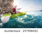 young lady paddling hard the... | Shutterstock . vector #257908352