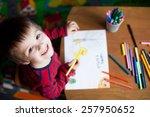 adorable little boy  drawing... | Shutterstock . vector #257950652