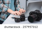female photographer working in... | Shutterstock . vector #257957312