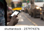 using cellphone outdoors while... | Shutterstock . vector #257974376