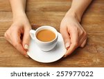 female hands holding cup of... | Shutterstock . vector #257977022
