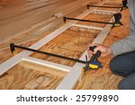 carpenter's hand adjusting... | Shutterstock . vector #25799890