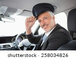 handsome chauffeur smiling at... | Shutterstock . vector #258034826