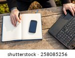 man working on notebook and... | Shutterstock . vector #258085256