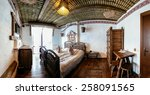 """Small photo of Unique ethnic interior. Traditional (national) design. The hotel room. Ukrainian style and specific decorations of serfdom historical period. Europe, Ukraine, Carpathians, Hotel """"History""""."""