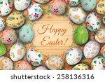 easter eggs on the wooden table.... | Shutterstock .eps vector #258136316