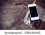 white smartphone  and brown... | Shutterstock . vector #258146342
