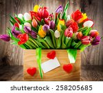 tulips in the box on wooden... | Shutterstock . vector #258205685
