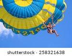 Happy Man Flying Parasailing