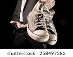 businessman holding dirty... | Shutterstock . vector #258497282