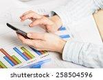 businesswoman hands analyzing...   Shutterstock . vector #258504596