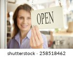 store owner turning open sign... | Shutterstock . vector #258518462