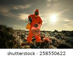 Small photo of Recycling worker inspecting wastes according to landfill waste acceptance criteria.