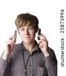 Man with two cellphones - stock photo