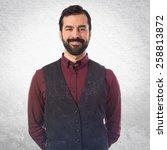 elegant man wearing waistcoat  | Shutterstock . vector #258813872