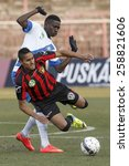Small photo of BUDAPEST, HUNGARY - MARCH 8, 2015: David Izazola of Honved (r) is fouled by Thiam Khaly Iyane of MTK during Honved vs. MTK OTP Bank League football match in Bozsik Stadium.