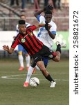 Small photo of BUDAPEST, HUNGARY - MARCH 8, 2015: Anibal Godoy of Honved (l) is fouled by Thiam Khaly Iyane of MTK during Honved vs. MTK OTP Bank League football match in Bozsik Stadium.