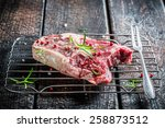 Beef with rosemary and pepper ready for grilling - stock photo