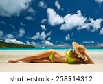 woman in yellow bikini lying on ... | Shutterstock . vector #258914312