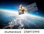 space satellite orbiting the... | Shutterstock . vector #258972995