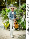 Small photo of Mariachi singer playing a guitar in Mexico