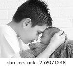 Newborn Baby Being Held...