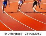 Running Athletes At Stadium In...