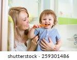 mother teaching son child teeth ...   Shutterstock . vector #259301486