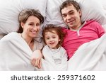 above view of a family lying on ... | Shutterstock . vector #259371602